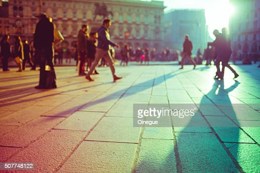 Intentionally blurred filtered vintage of defocused people walking : Stock Photo
