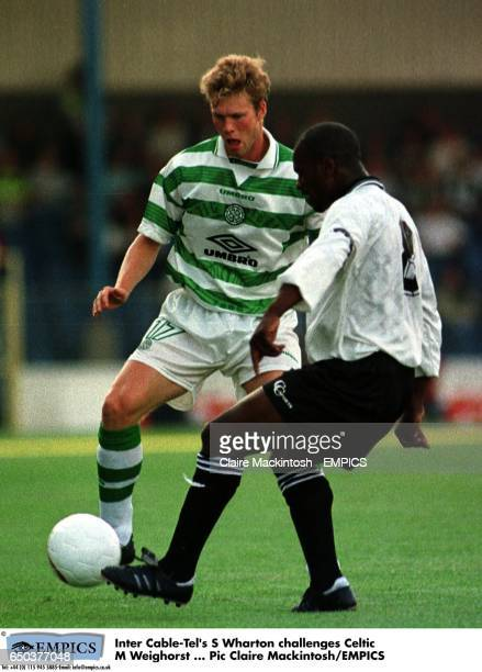 Inter CableTel's S Wharton challenges Celtic's Morten Wieghorst