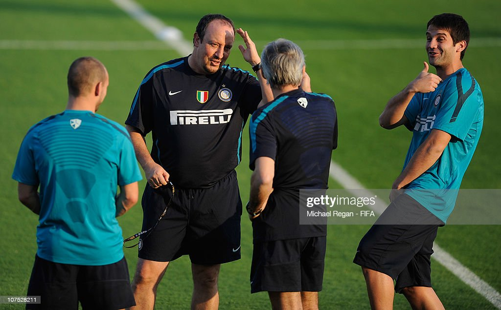Inter coach Rafael Benitez laughs with <a gi-track='captionPersonalityLinkClicked' href=/galleries/search?phrase=Cristian+Chivu&family=editorial&specificpeople=675968 ng-click='$event.stopPropagation()'>Cristian Chivu</a> during the FC Internazionale Milano training session at the Army Training Ground on December 11, 2010 in Abu Dhabi, United Arab Emirates.