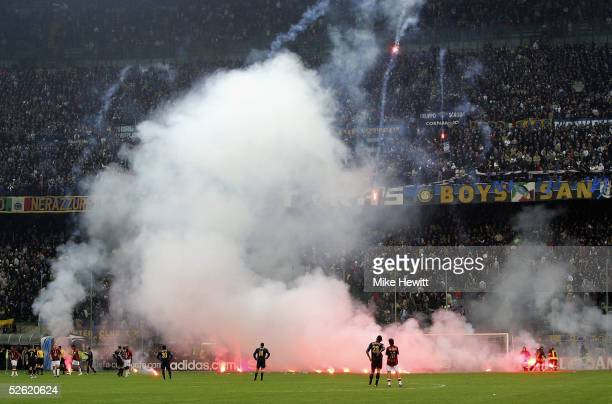 Inter fans shower the pitch with flares during the UEFA Champions League quarterfinal second leg between AC Milan and Inter Milan at the San Siro...