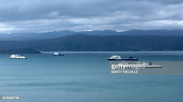 Inter Island ferries are anchored in the harbour area awaiting repairs to the loading ramps in Wellington after a 78 earthquake struck the South...
