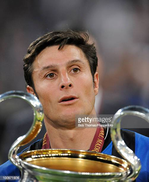 Inter Milan captain Javier Zanetti celebrates with the trophy after winning the UEFA Champions League Final match between Bayern Munich and Inter...