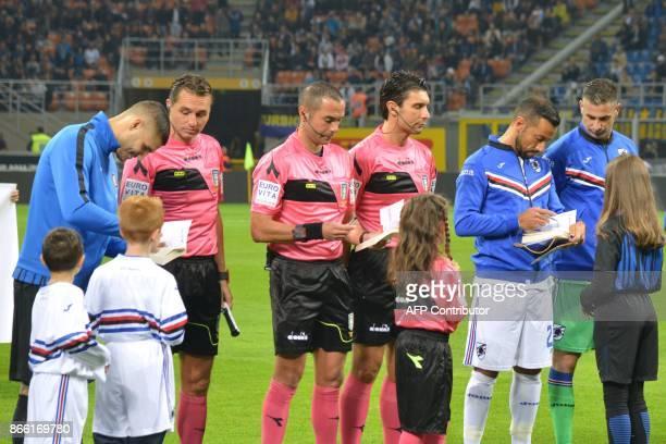 Inter Milan captain Mauro Icardi Sampdoria counterpart Fabio Quagliarella and referee Marco Guida sign copies of 'The Diary of Anne Frank' and...