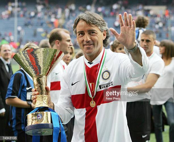 Inter Milan coach Roberto Mancini celebrates with the Scudetto trophy after the Serie A match between Inter Milan and Torino at the Stadio Giuseppe...