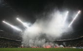 Inter Milan fans shower the pitch with flares after referee Marcus Merk of Germany disallowed a goal during the UEFA Champions League quarterfinal...
