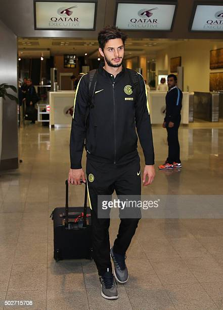Inter Milan football club's player Andrea Ranocchia arrives at Doha's International airport on December 28 two days ahead of a friendly match between...