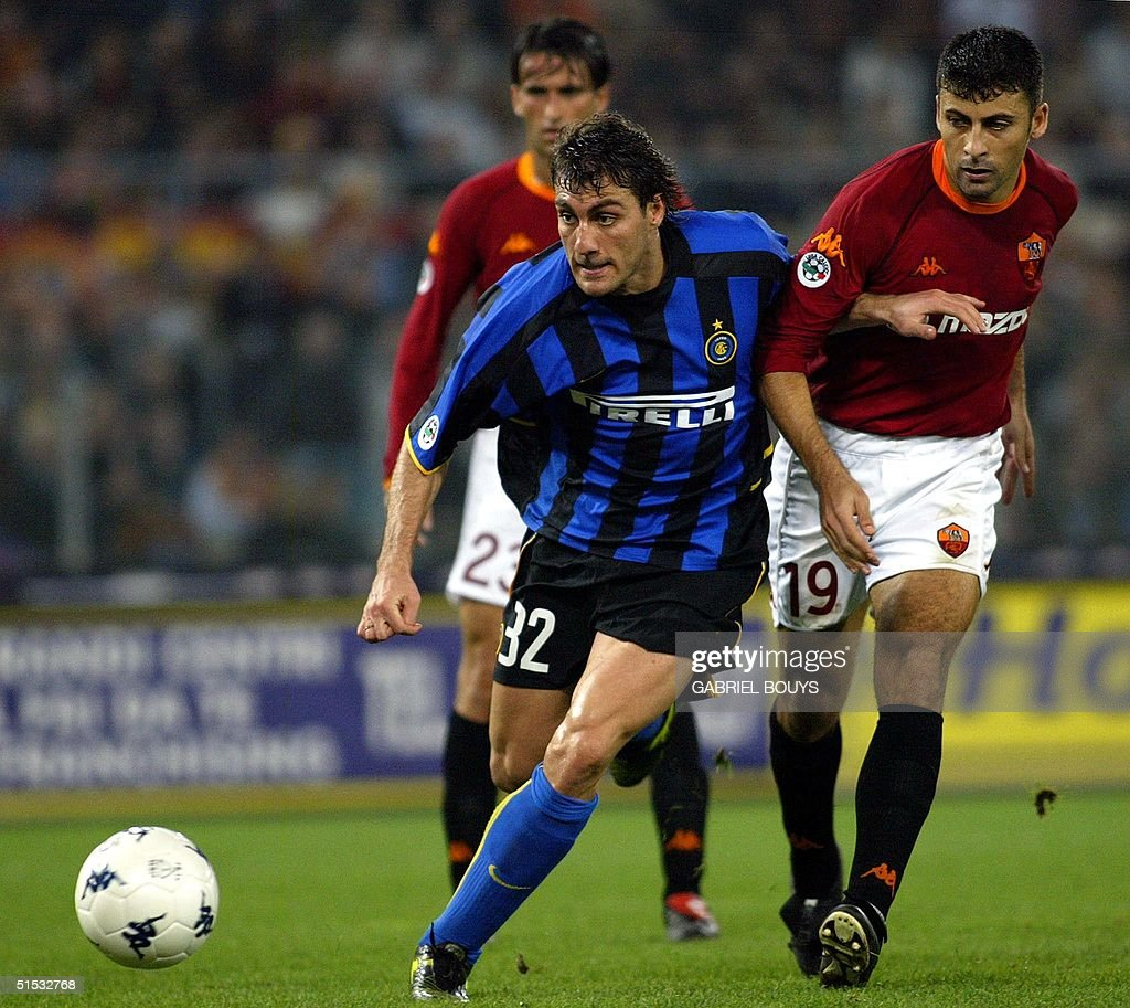 Inter Milan forward Christian Vieri C fights for