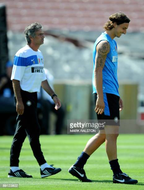 Inter Milan forward Zlatan Ibrahimovic smiles beside coach José Mourinho as they train at the Rose Bowl on the eve of their game against Chelsea in...