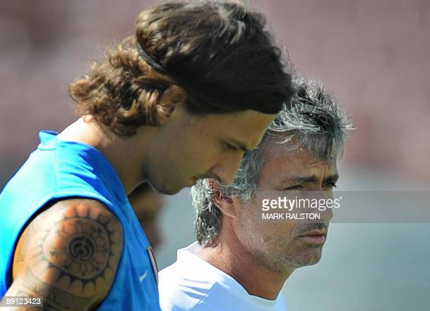 Inter Milan forward Zlatan Ibrahimovic talks with coach José Mourinho as they train at the Rose Bowl on the eve of their game against Chelsea in Los...