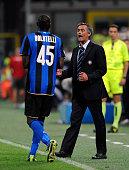 Inter Milan head coach Josè Mourinho congratulates goal scorer Mario Balotelli during the Serie A match between Inter Milan Milan and AC Siena at the...