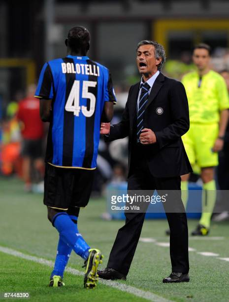 Inter Milan head coach Josè Mourinho congratulates goal scorer Mario Balotelli during the Serie A match between Inter Milan Milan and AC Siena at the...