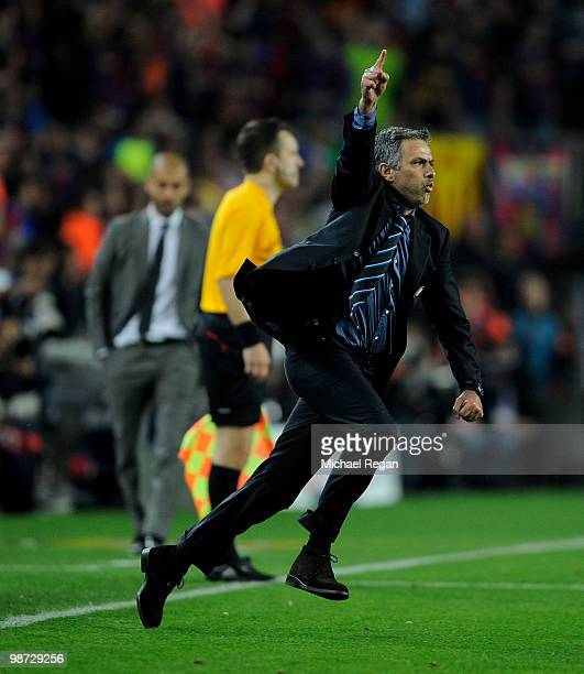 Inter Milan manager Jose Mourinho celebrates victory as barcelona manager Josep Guardiola looks on during the UEFA Champions League Semi Final Second...