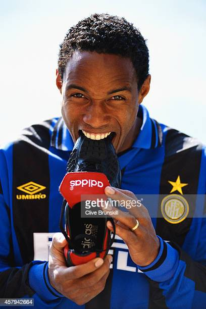 Inter Milan player Paul Ince playfully bites his boot during a Adidas photoshoot in July 1995 in Milan Italy