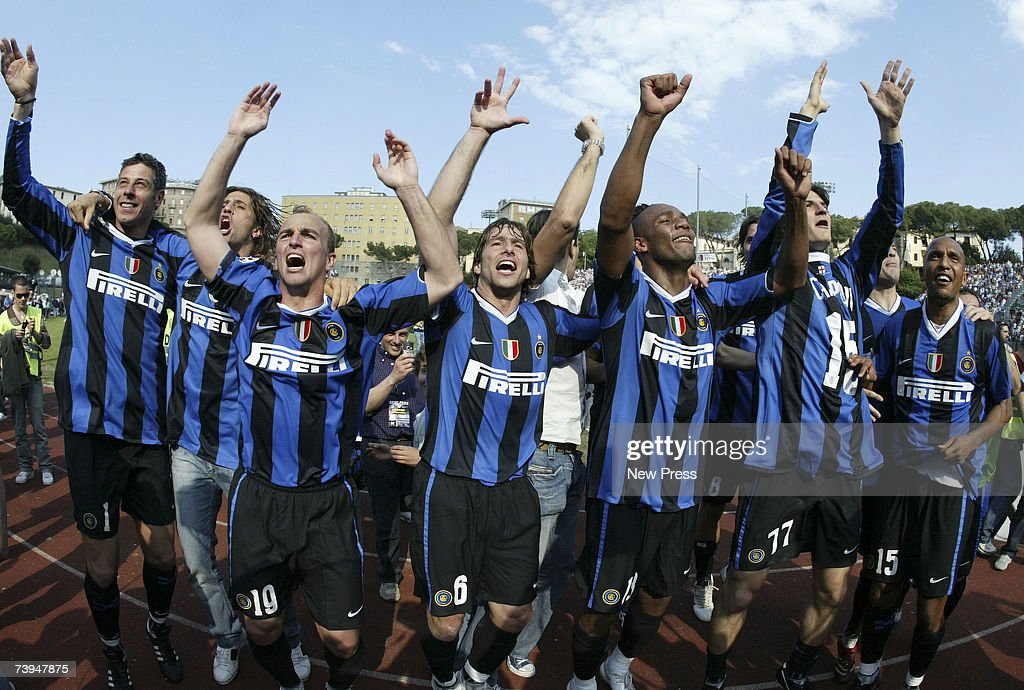 Inter Milan players celebrate after winning the Italian Serie A football match between AC Siena and FC Inter Milan at the Stadio Artemio Franchi on...