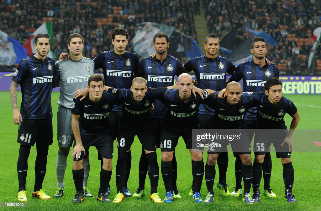FC Inter Milan players line up for a team photo before the start of the Serie A match between FC Internazionale Milano and Hellas Verona at Stadio Giuseppe Meazza on October 26, 2013 in Milan, Italy.