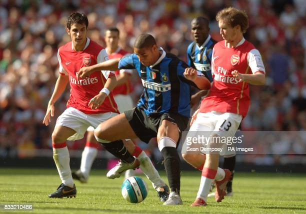 Inter Milan's Adriano battles for the ball with Arsenal's Francesc Fabregas and Alexander Hleb