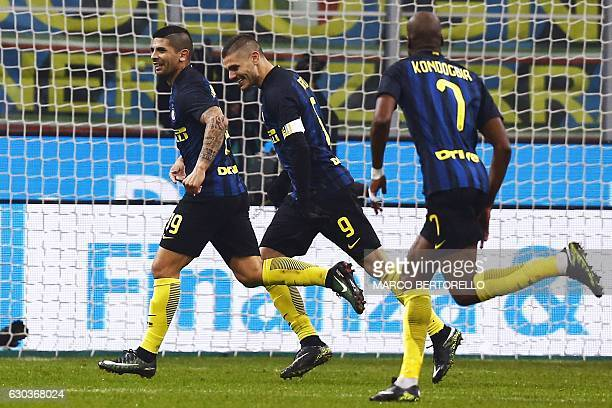 Inter Milan's Argentinan midfielder Ever Banega celebrates with Inter Milan's Argentinan forward Mauro Emanuel Icardi after socring a goal during the...