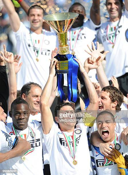 Inter Milan's Argentinian defender and captain Javier Aldemar Zanetti holds the Cup during the trophy ceremony of the Italian Serie A title on May 16...