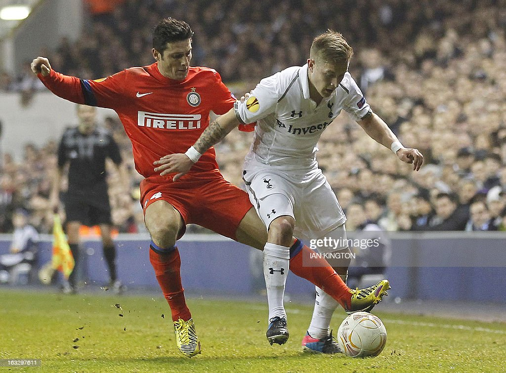 Inter Milan's Argentinian defender Javier Zanetti (L) vies for the ball against Tottenham Hotspur's footballer Lewis Holtby during a UEFA Europa League Round of 16 football match between Tottenham Hotspur and Inter Milan at White Hart Lane in east London, on March 7, 2013.