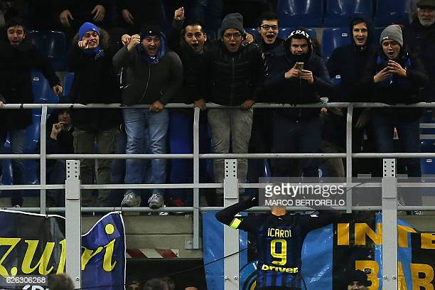 Inter Milan's Argentinian forward Mauro Emanuel Icardi celebrates with supporters after scoring a goal during the Italian Serie A football match...