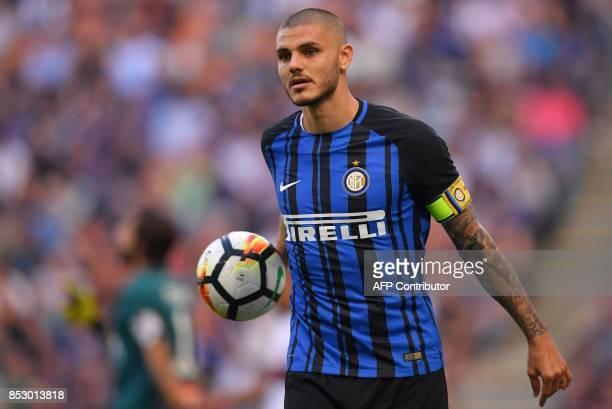 Inter Milan's Argentinian forward Mauro Emanuel Icardi holds the ball during the Italian Serie A football match Inter Milan vs Genoa on September 24...