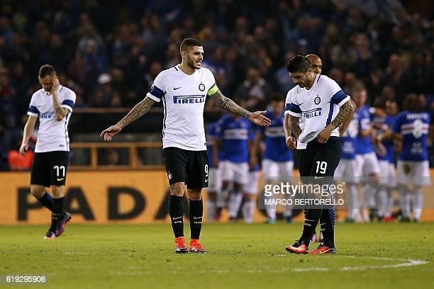 Inter Milan's Argentinian forward Mauro Emanuel Icardi reacts next to Inter Milan's Argentinian midfielder Ever Banega during the Italian Serie A...