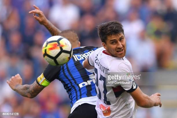 Inter Milan's Argentinian forward Mauro Emanuel Icardi vies with Genoa's Bosnian defender Ervin Zukanovic during the Italian Serie A football match...
