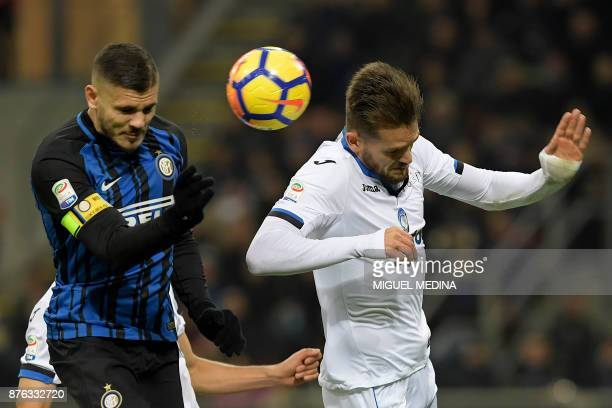Inter Milan's Argentinian forward Mauro Icardi and Atalanta's Brazilian defender Rafael Toloi go for a header during the Italian Serie A football...