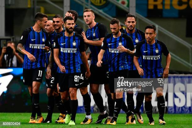 Inter Milan's Argentinian forward Mauro Icardi celebrates with teammates after scoring his second goal during the Italian Serie A football match...