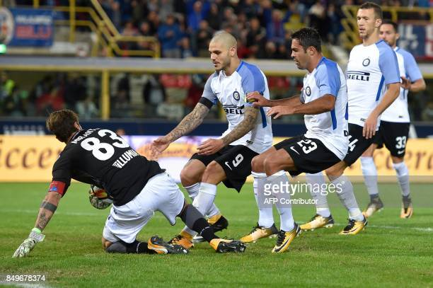 Inter Milan's Argentinian forward Mauro Icardi celebrates with teammate Eder after scoring past Bologna goalkeeper Antonio Mirante during the Italian...