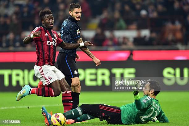 Inter Milan's Argentinian forward Mauro Icardi eyes the ball flanked by AC Milan's Ghanaian midfielder Sulley Ali Muntari and AC Milan's Spanish...