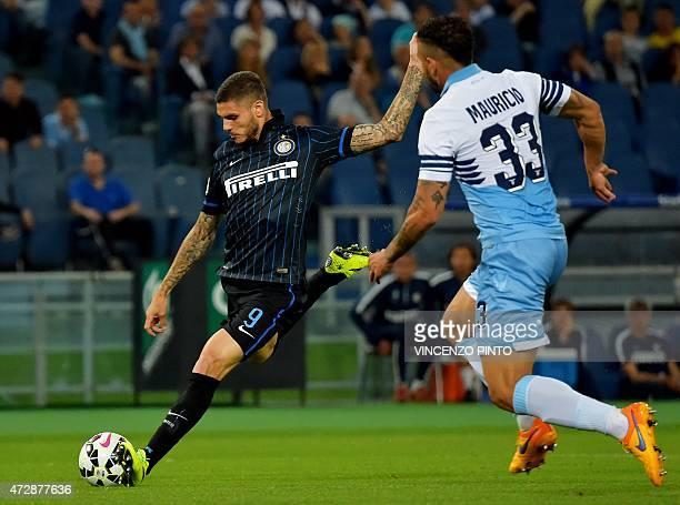 Inter Milan's Argentinian forward Mauro Icardi kicks the ball past Lazio's Brazilian defender Mauricio during their Italian Serie A football match...