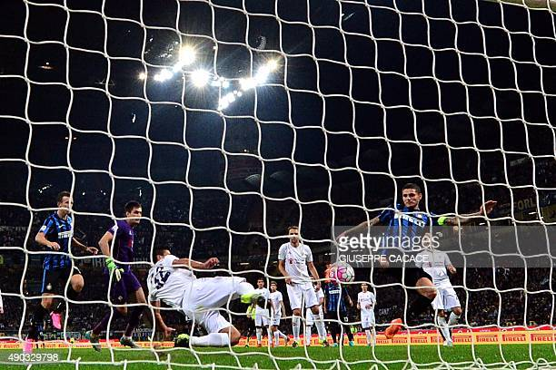 Inter Milan's Argentinian forward Mauro Icardi kicks to score a goal during the Serie A football match between Inter Milan and Fiorentina at the San...