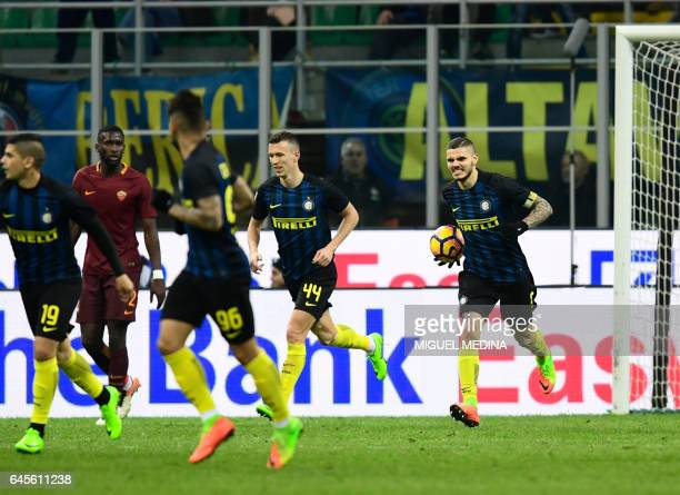 Inter Milan's Argentinian forward Mauro Icardi reacts after scoring a goal during the Italian Serie A football match Inter Milan vs AS Roma at the...