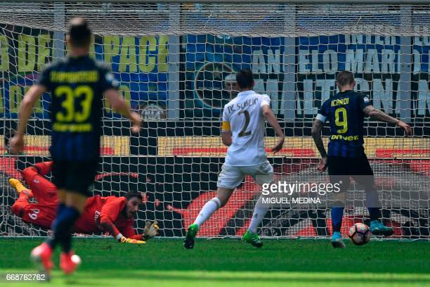 Inter Milan's Argentinian forward Mauro Icardi scores during the Italian Serie A football match Inter Milan vs AC Milan at the San Siro stadium in...