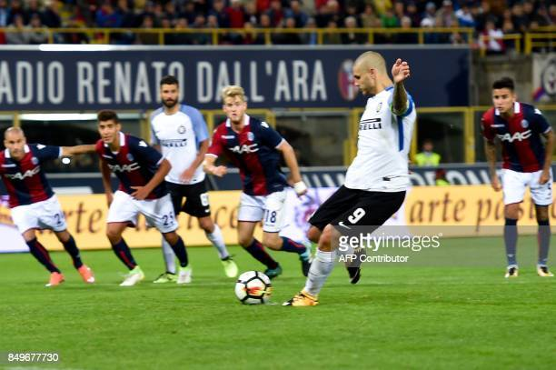 Inter Milan's Argentinian forward Mauro Icardi shoots and scores a penalty during the Italian Seriea A match Bologna versus Inter Milan at The Dall'...