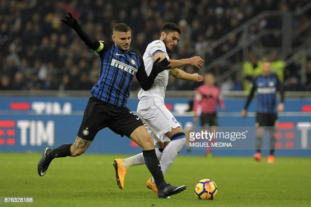 Inter Milan's Argentinian forward Mauro Icardi vies with Atalanta's Argentinian defender Jose Luis Palomino during the Italian Serie A football match...