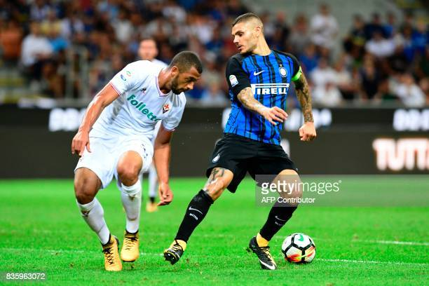 Inter Milan's Argentinian forward Mauro Icardi vies with Fiorentina's Brazilian defender Vitor Hugo during the Italian Serie A football match Inter...