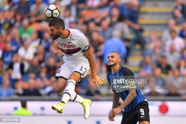 Inter Milan's Argentinian forward Mauro Icardi vies with Genoa's Italian defender Luca Rossettini during the Italian Serie A football match Inter...