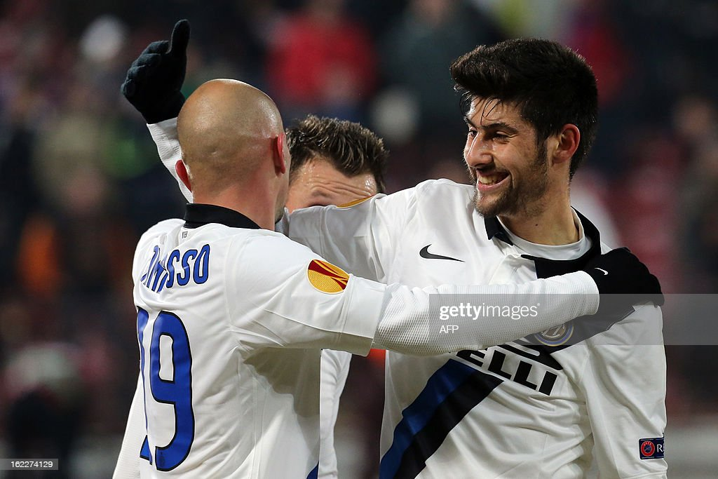 Inter Milan's Argentinian midfielder Esteban Matias Cambiasso (L) and Inter Milan's midfielder Marco Benassi (R) celebrate after the UEFA Europa League Round of 32 football match CFR 1907 Cluj vs Inter Milan in Cluj, northern Romania on February 21, 2013. Inter Milan won the mach 0-3.