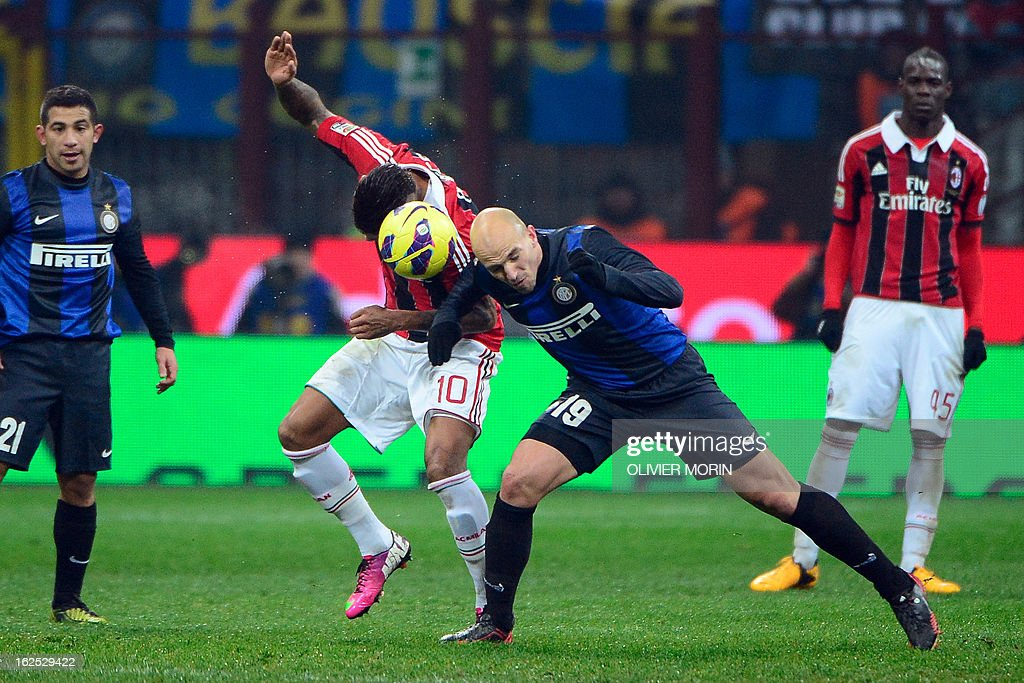 Inter Milan's Argentinian midfielder Esteban Matias Cambiasso (L) fights for the ball with AC Milan's Ghanaian defender Prince Kevin Boateng during the serie A match between Inter MIlan and AC Milan on February 24, 2013 in Milan, at the San Siro stadium.