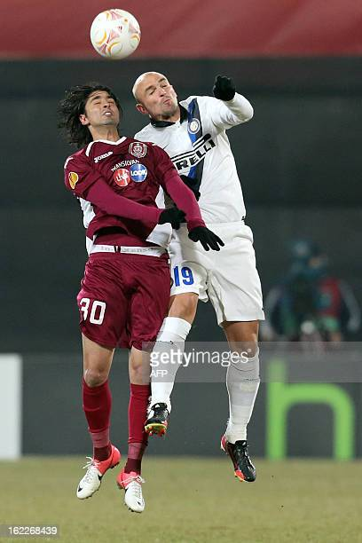 Inter Milan's Argentinian midfielder Esteban Matias Cambiasso vies for the ball with Cluj's Portuguese forward Rui Pedro during the UEFA Europa...