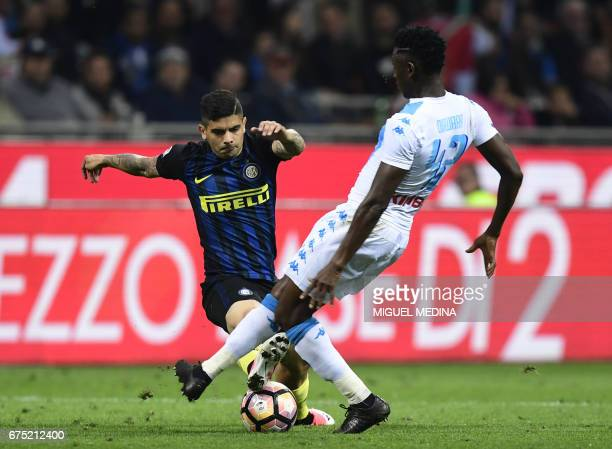 Inter Milan's Argentinian midfielder Ever Banega challenges Napoli's Guinean midfielder Amadou Diawara during the Italian Serie A football match...