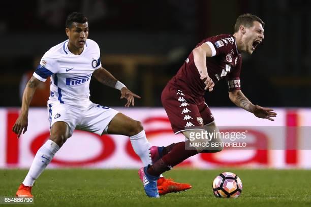 Inter Milan's Brazil defender Joao Miranda de Souza Filho vies for the ball with Torino's forward Andrea Belotti during the Italian Serie A football...