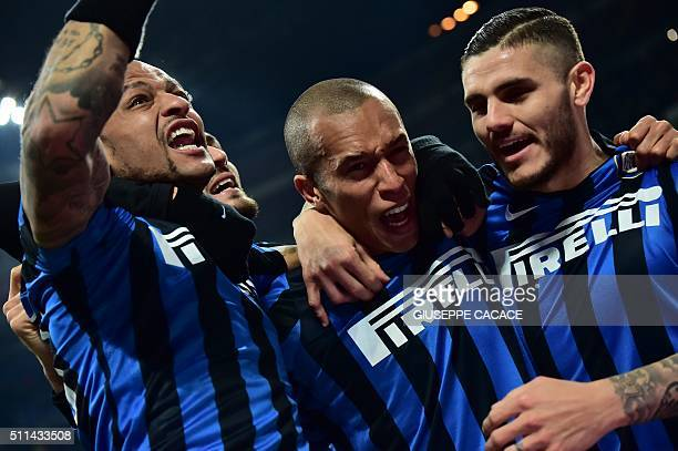 Inter Milan's Brazilian defender Joao Miranda celebrates after scoring a goal with Inter Milan's Argentinian forward Mauro Icardi and Inter Milan's...
