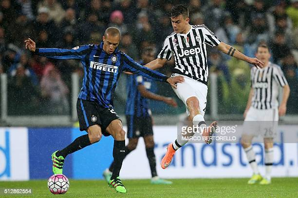 Inter Milan's Brazilian defender Joao Miranda de Souza Filho vies with Juventus' Argentinian forward Paulo Dybala during the Italian Serie A football...