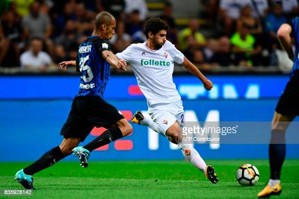 Inter Milan's Brazilian defender Joao Miranda vies with Fiorentina's Portuguese midfielder Gil Dias during the Italian Serie A football match Inter...
