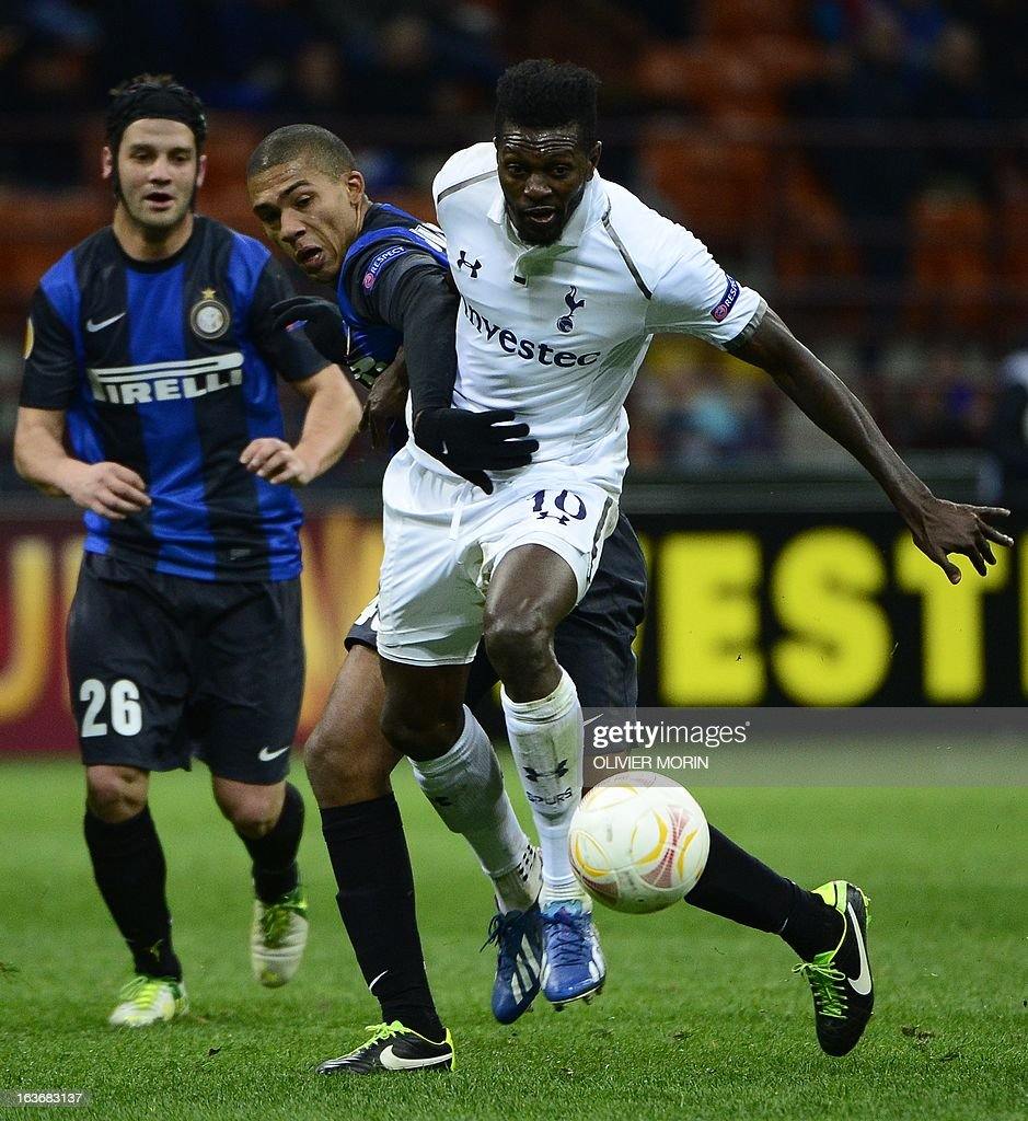 Inter Milan's Brazilian defender Juan Guilherme Nunes Jesus (L) fights for the ball with Tottenham Hotspur's Togolese striker Emmanuel Adebayor during the European Cup football match between Inter Milan and Tottenham, on March 14, 2013 at the San Siro stadium in Milan. AFP PHOTO / OLIVIER MORIN
