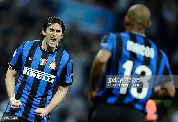 Inter Milan's Brazilian defender Maicon celebrates with teammate Argentinian Diego Milito after scoring against Barcelona during the UEFA Champions...