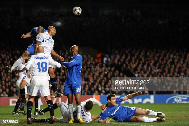 Inter Milan's Brazilian defender Maicon heads the ball flanked by Chelsea's Brazilian defender Alex during the second leg in the round of 16 UEFA...
